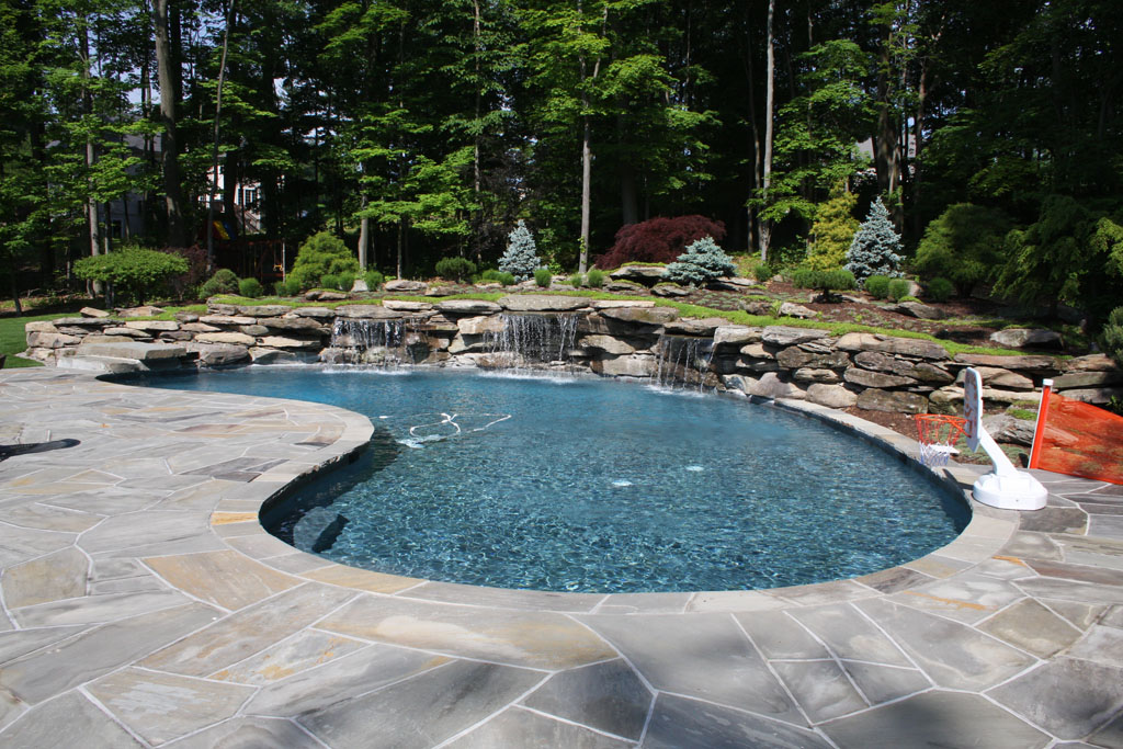 Modern pool landscaping ideas with rocks and plants for Large swimming pool designs