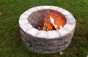 DIY outdoor fireplace with bricks